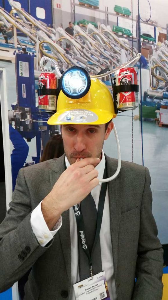 Robert Keeler from Carbis Loadtectrying out a special hard hat at StocExpo 2016