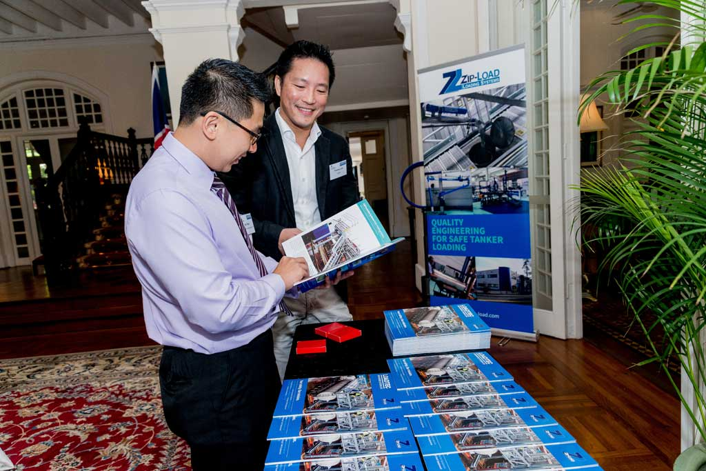 Guests checking out new Loadtec brochure in Eden Hall, Singapor