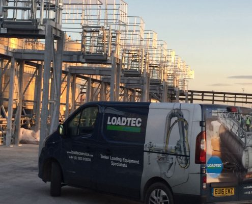 Our Carbis Loadtec Service team van out in Teesside on an installation job - Folding stairs and large safety cages in the background