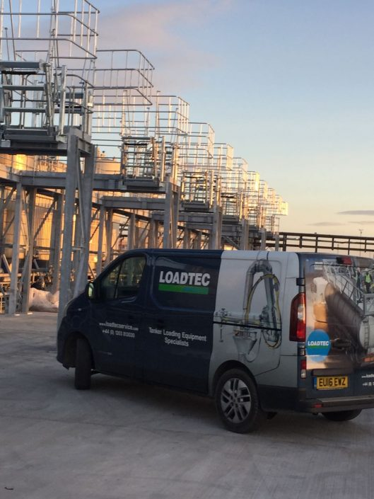 Our Loadtec Service team van out in Teesside on an installation job - Folding stairs and large safety cages in the background