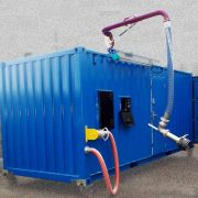 Carbis Loadtec Skid Load System - Single loading arm, pumping, metering and overfill protection, in container - UK