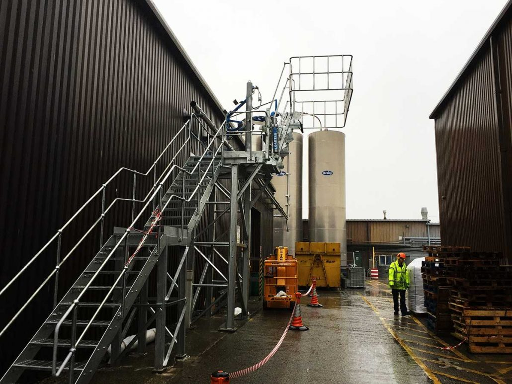 Carbis Loadtec Loading Platform with Wide Safety Cage and Folding Stairs, Albis Plastics, Knutsford, UK