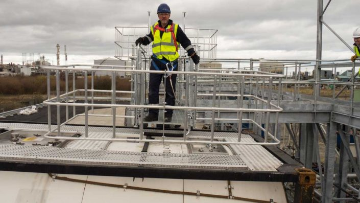 Loadtec Service Team Rob Williams on Top of Large Safety Cage - Teesside, UK