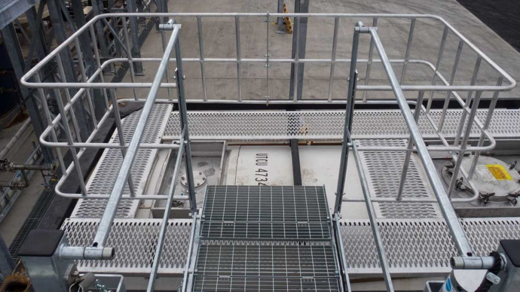 Carbis Loadtec Service Top View from Folding Stairs Onto Large Safety Cage - Teesside, UK
