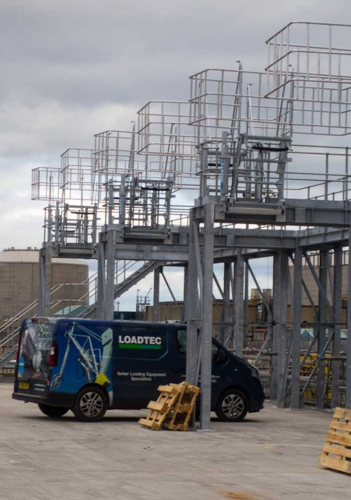 Loadtec Service Van Under Newly Installed Large Safety Cage and Folding Stairs