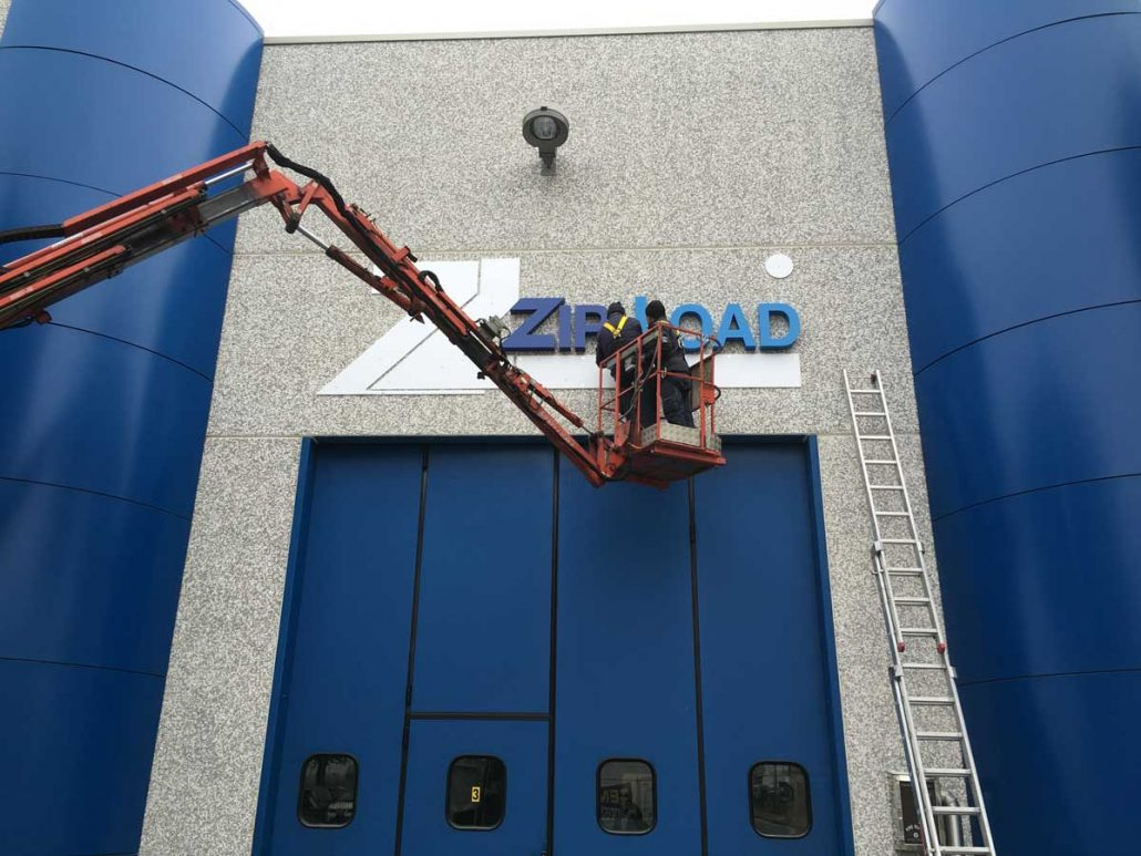 Zip-Load signage going up at the factory in Bologna, Italy