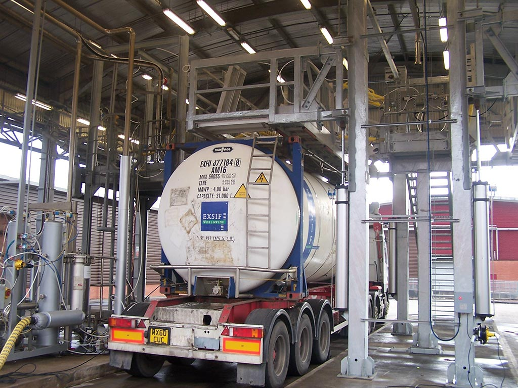 Carbis Loadtec Tanker Enclosure System TCEN4 being lowered onto an ISO container