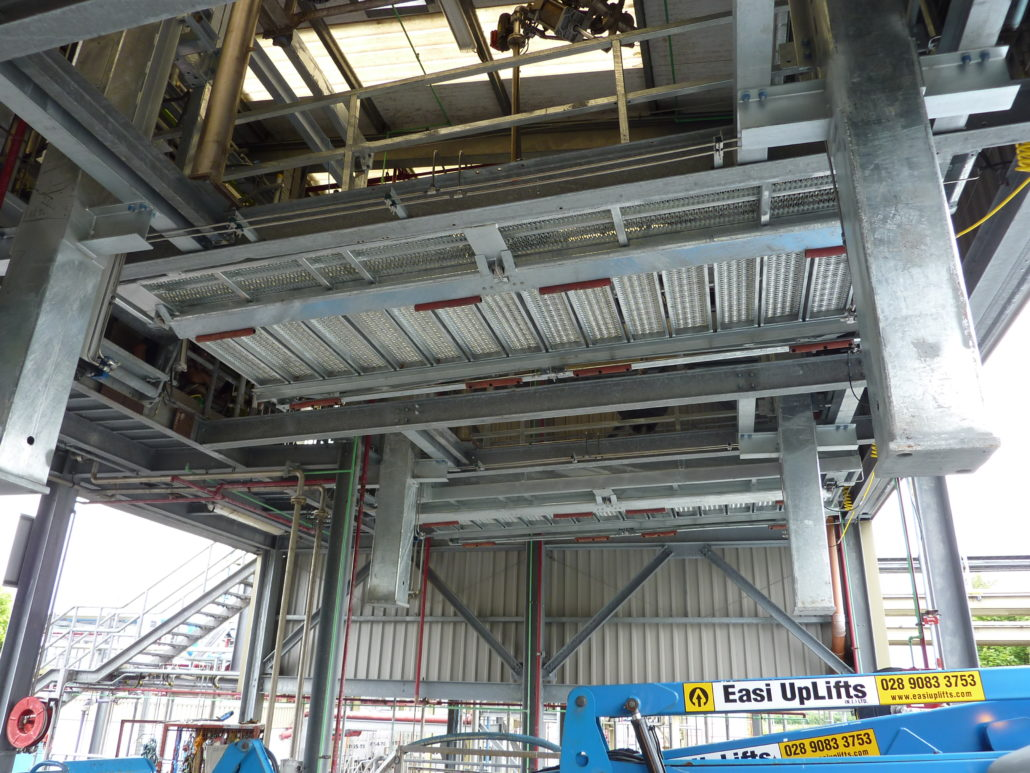 Carbis Loadtec Vertically Elevating Platform suspended from the roof of the building